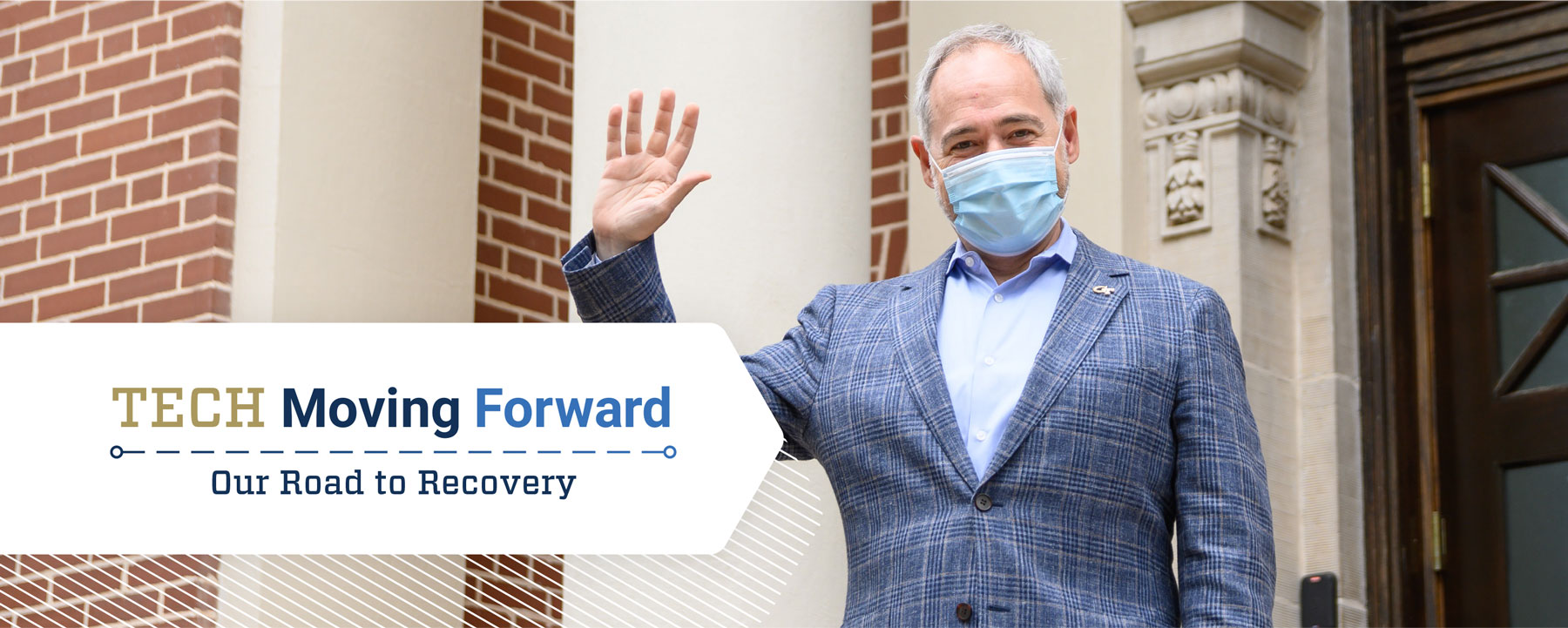 President Cabrera in a face mask welcoming people safely back to campus with a hand wave